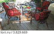 Купить «Терраса с плетеной мебелью», видеоролик № 3829669, снято 12 сентября 2012 г. (c) Yaroslav Bokotey / Фотобанк Лори