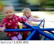 Купить «Две девочки катаются на карусели», фото № 3830405, снято 8 сентября 2012 г. (c) Liseykina / Фотобанк Лори