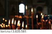Купить «Русская православная церковь. Горящие свечи», видеоролик № 3835581, снято 14 сентября 2012 г. (c) Mikhail Erguine / Фотобанк Лори