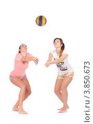 Купить «Две девушки играют в волейбол на белом фоне», фото № 3850673, снято 28 июня 2012 г. (c) Tatjana Romanova / Фотобанк Лори