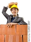 Купить «Строитель кладет кирпич на голову», фото № 3857897, снято 22 мая 2012 г. (c) Elnur / Фотобанк Лори