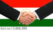 Мужское рукопожатие на фоне флага Таджикистана. Стоковое фото, фотограф Александр Макаров / Фотобанк Лори