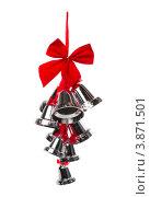 Купить «Серебренные колокольчики с красной ленточкой на рождество», фото № 3871501, снято 3 сентября 2011 г. (c) Tatjana Romanova / Фотобанк Лори