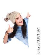 Купить «Студентка выглядывает из-за белой доски - баннера», фото № 3871561, снято 5 сентября 2012 г. (c) Tatjana Romanova / Фотобанк Лори