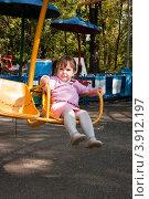 Купить «Девочка катается на карусели в парке», фото № 3912197, снято 3 октября 2012 г. (c) WalDeMarus / Фотобанк Лори