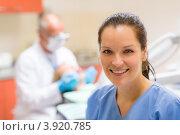 Купить «Улыбающаяся помощница стоматолога в кабинете», фото № 3920785, снято 9 июня 2012 г. (c) CandyBox Images / Фотобанк Лори