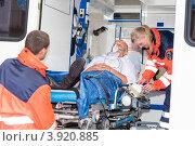 Купить «Мужчина и врачи в машине скорой помощи», фото № 3920885, снято 25 июля 2012 г. (c) CandyBox Images / Фотобанк Лори