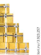 Купить «Золотые коробки с серебряной ленточкой на праздник в подарок», фото № 3923257, снято 18 августа 2012 г. (c) Tatjana Romanova / Фотобанк Лори