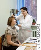 Купить «Пациентка на приеме у окулиста», фото № 3960013, снято 5 декабря 2011 г. (c) Яков Филимонов / Фотобанк Лори