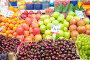 Фрукты и черешня в лотках на продуктовом рынке, фото № 3973545, снято 7 февраля 2010 г. (c) Elnur / Фотобанк Лори