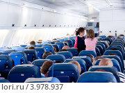 Купить «В салоне самолета Ил-96. Чартерный рейс», эксклюзивное фото № 3978937, снято 17 июня 2012 г. (c) Володина Ольга / Фотобанк Лори