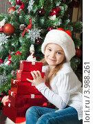 Купить «Счастливая девочка с подарками около новогодней елки», фото № 3988261, снято 4 ноября 2012 г. (c) Оксана Гильман / Фотобанк Лори