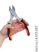 Купить «Рука с кусачками на белом фоне», фото № 4015057, снято 14 марта 2011 г. (c) Phovoir Images / Фотобанк Лори