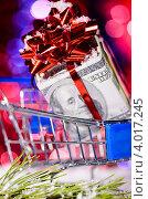Купить «Подарок из долларов в тележке на новогоднем фоне», фото № 4017245, снято 8 декабря 2011 г. (c) Сергей Петерман / Фотобанк Лори