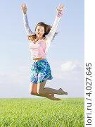 Купить «Девушка в голубых шортиках прыгает в поле в солнечный летний день», фото № 4027645, снято 7 мая 2011 г. (c) Сергей Сухоруков / Фотобанк Лори