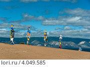 Купить «Ритуальные шаманские столбы с цветными ленточками на острове Ольхон», фото № 4049585, снято 11 августа 2011 г. (c) Opra / Фотобанк Лори