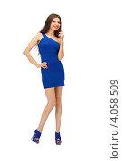 Купить «Юная девушка с темными волосами в синем платье на каблуках на белом фоне», фото № 4058509, снято 27 июня 2012 г. (c) Syda Productions / Фотобанк Лори