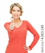 Купить «Жизнерадостная блондинка в красном свитере подняла большой палец на руке вверх на белом фоне», фото № 4063245, снято 24 марта 2012 г. (c) Syda Productions / Фотобанк Лори