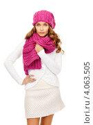 Купить «Привлекательная юная девушка в брусничного цвета вязаном шарфе и шапке на белом фоне», фото № 4063505, снято 10 октября 2010 г. (c) Syda Productions / Фотобанк Лори