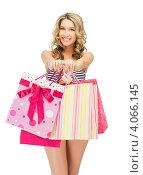 Купить «Юная стройная девушка в бикини с пакетами покупок в руках», фото № 4066145, снято 24 марта 2012 г. (c) Syda Productions / Фотобанк Лори