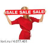 Купить «Молодая привлекательная блондинка в красном платье с баннером со знаком скидки на белом фоне», фото № 4077401, снято 7 октября 2012 г. (c) Syda Productions / Фотобанк Лори