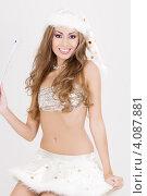 Купить «Привлекательная жизнерадостная сексуальная девушка в колпаке Санта-Клауса», фото № 4087881, снято 20 сентября 2008 г. (c) Syda Productions / Фотобанк Лори