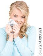 Купить «Молодая женщина с деньгами и кошельком на белом фоне», фото № 4093921, снято 26 сентября 2009 г. (c) Syda Productions / Фотобанк Лори