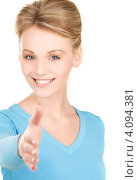 Купить «Молодая женщина протягивает руу для рукопожатия», фото № 4094381, снято 12 декабря 2009 г. (c) Syda Productions / Фотобанк Лори