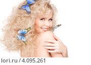 Купить «Кудрявая блондинка с голубыми бабочками в волосах», фото № 4095261, снято 21 ноября 2009 г. (c) Syda Productions / Фотобанк Лори