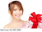 Купить «Довольная молодая женщина с подарком, перевязанным лентой», фото № 4107581, снято 4 октября 2009 г. (c) Syda Productions / Фотобанк Лори