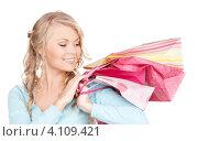 Купить «Довольная молодая женщина с многочисленными покупками в пакетах на белом фоне», фото № 4109421, снято 26 сентября 2009 г. (c) Syda Productions / Фотобанк Лори
