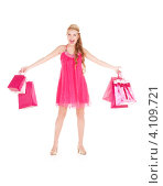 Купить «Довольная молодая женщина с многочисленными покупками в пакетах на белом фоне», фото № 4109721, снято 17 октября 2009 г. (c) Syda Productions / Фотобанк Лори