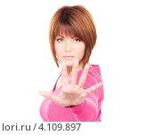 """Купить «Привлекательная молодая женщина протянула руку в жесте """"стоп""""», фото № 4109897, снято 26 декабря 2009 г. (c) Syda Productions / Фотобанк Лори"""