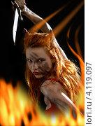 Купить «Рыжая дьяволица в огне на черном фоне», фото № 4119097, снято 9 апреля 2007 г. (c) Syda Productions / Фотобанк Лори