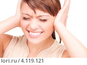 Купить «Привлекательная девушка затыкает уши ладонями на белом фоне», фото № 4119121, снято 22 ноября 2009 г. (c) Syda Productions / Фотобанк Лори