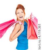 Купить «Довольная девушка с покупками в ярких пакетах в руках после шоппинга», фото № 4119361, снято 14 ноября 2009 г. (c) Syda Productions / Фотобанк Лори