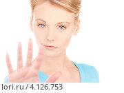 """Купить «Молодая женщина показывает на руках жест """"Стоп""""», фото № 4126753, снято 12 декабря 2009 г. (c) Syda Productions / Фотобанк Лори"""