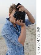 Профессиональный фотограф (2012 год). Редакционное фото, фотограф Михаил Бессмертный / Фотобанк Лори
