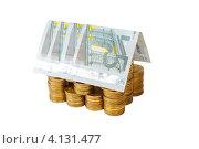Купить «Дом построенный из монет и банкнот, белый фон», фото № 4131477, снято 25 ноября 2012 г. (c) Mikhail Starodubov / Фотобанк Лори