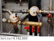 Купить «Установленный комплект счетчиков расхода воды», фото № 4142069, снято 2 декабря 2012 г. (c) Orion34 / Фотобанк Лори