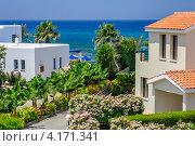 Купить «Виллы на берегу моря на Кипре», фото № 4171341, снято 30 июня 2012 г. (c) Евгений Дробжев / Фотобанк Лори