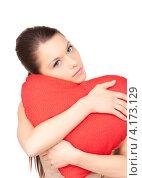 Купить «Красивая молодая женщина обнимает красную подушку в форме сердца на белом фоне», фото № 4173129, снято 28 февраля 2010 г. (c) Syda Productions / Фотобанк Лори