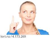 Купить «Молодая женщина предупреждающе подняла указательный палец на белом фоне», фото № 4173269, снято 8 мая 2010 г. (c) Syda Productions / Фотобанк Лори
