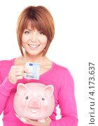 Купить «Довольная молодая женщина с розовой копилкой в форме свиньи на белом фоне», фото № 4173637, снято 26 декабря 2009 г. (c) Syda Productions / Фотобанк Лори