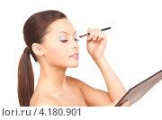 Купить «Привлекательная девушка с палеткой и кистью на белом фоне», фото № 4180901, снято 28 февраля 2010 г. (c) Syda Productions / Фотобанк Лори
