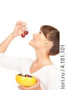 Купить «Привлекательная девушка с челкой со сладкой черешней на белом фоне», фото № 4181101, снято 27 июня 2010 г. (c) Syda Productions / Фотобанк Лори