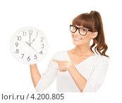 Купить «Веселая молодая женщина с круглыми большими часами на белом фоне», фото № 4200805, снято 27 июня 2010 г. (c) Syda Productions / Фотобанк Лори