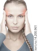 Купить «Несчастная молодая женщина устало держится за голову», фото № 4200961, снято 8 мая 2010 г. (c) Syda Productions / Фотобанк Лори