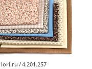 Стопка различных тканей. Стоковое фото, фотограф Евгений Заржицкий / Фотобанк Лори