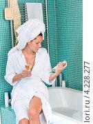 Купить «Девушка в белом халате и полотенце в ванной комнате», фото № 4228277, снято 23 сентября 2012 г. (c) CandyBox Images / Фотобанк Лори